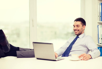smiling businessman or student with laptop