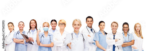 smiling female doctors and nurses with stethoscope - 75612913