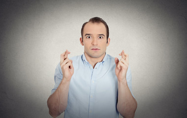 funny guy, anxious business man crossing fingers hoping