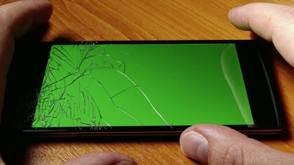 Broken Screen High-End Oppo Smartphone with Green Background