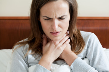 Woman having a sore throat