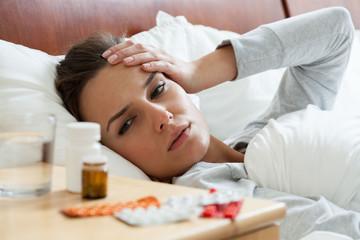 Ill woman feeling headache