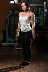 Woman Doing Exercise For Biceps