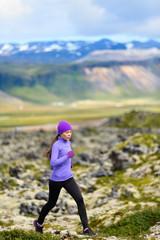 Runner - sport running woman in trail run