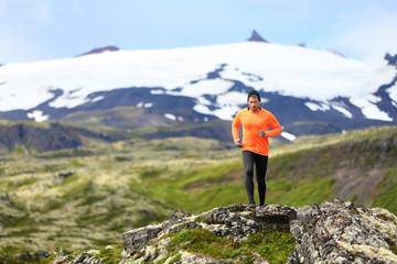Running man exercising - trail runner athlete