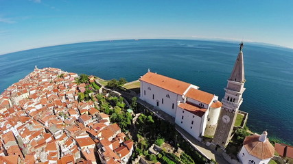 Flight and takeoff over old city Piran, aerial view