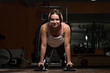 Young Woman Exercising Push Ups