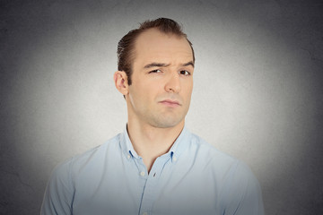 headshot angry, mad, annoyed, skeptical, grumpy business man