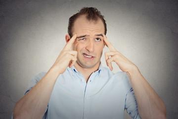 headshot businessman thinking trying hard to remember something