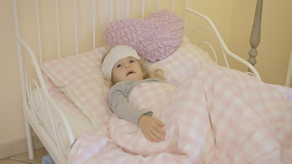 Little girl sick in bed waking up from nightmare