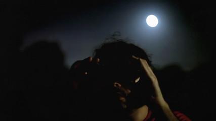 Man binoculars night