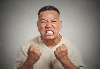 headshot angry man with open mouth fist up in air screaming