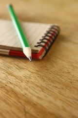 Pencil and a notebook on a table