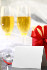 Card with two glasses of champagne and gift box