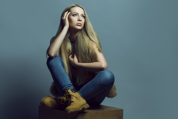 Emotional portrait of a gorgeous fashion blond model  posing ove