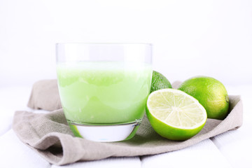 Glass of fresh lime juice with pieces of kiwi