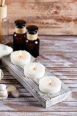 Composition of candles and bottles with massage oil