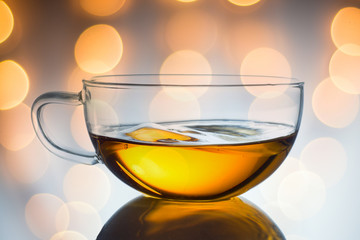 Glass cup of black tea. on light background