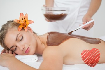 Beautiful blonde enjoying a chocolate beauty treatment