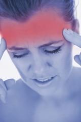 Unhappy woman with severe headache