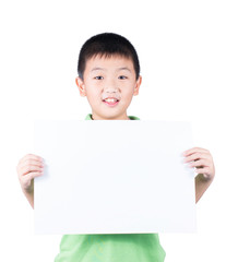 Smiling boy standing with empty horizontal blank paper in hands