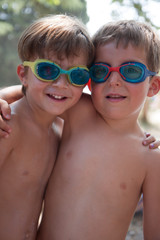 portrait of children with swimming goggles