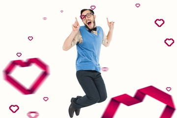 Composite image of geeky hipster jumping and smiling