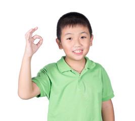 Cute boy making Ok sign isolated on white background