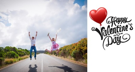 Composite image of excited couple jumping on the road