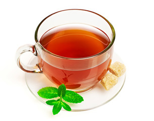 Cup of tea with mint and sugar