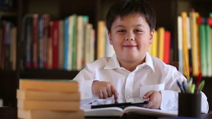 little school boy using digital tablet