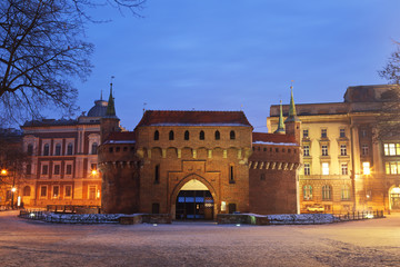 A gate to Krakow , Poland by night