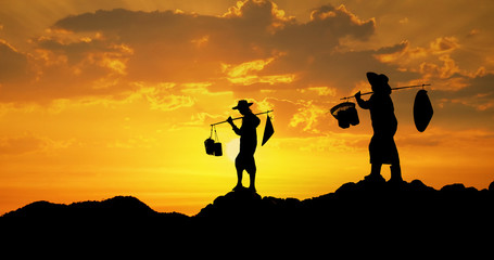 Thai farmer on sunset