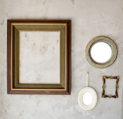 Set of different modern and ancient mirrors and photo frame.