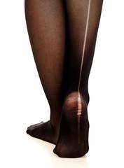 Female legs in torn pantyhose