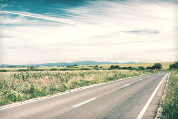 Retro Photo Of Country Road Landscape In Summer