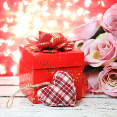 Valentine Card.Roses and Hearts on natural bokeh.