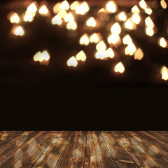 wooden deck table over heart bokeh background. Valentine's day