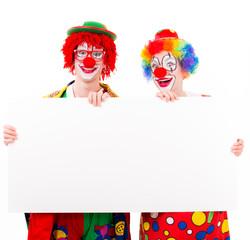 lachende clowns mit werbetafel