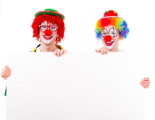 clowns mit werbeschild