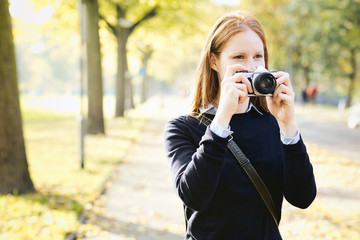 Amateur Photographer in a City Park
