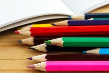 Multicolored pencils with album closeup