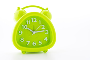 Green alarm clock isolated on white background