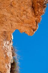 Red soft limestone rock in La Zenia, Costa Blanca, Spain.