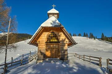 Chapel in the Alpine meadow in Winter