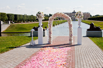 Wedding arch of different colors on a background of the river an
