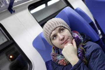 Pensive woman in a train