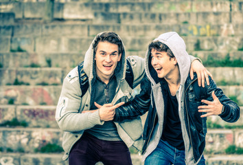 Young hipster brothers having fun with each other - Best friends