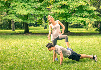 Girlfriend mocking her boyfriend while training in the park