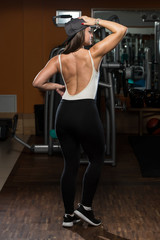 Woman In Gym Showing Her Well Trained Body